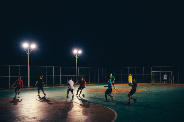 Footballers playing street ball, showing good touches.